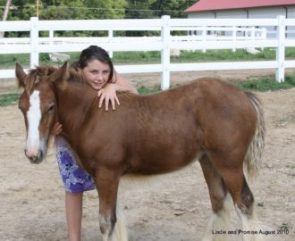 A 10-year-old Lindie Barton poses for a photo with LexLin's Lindie's Promise in 2010.