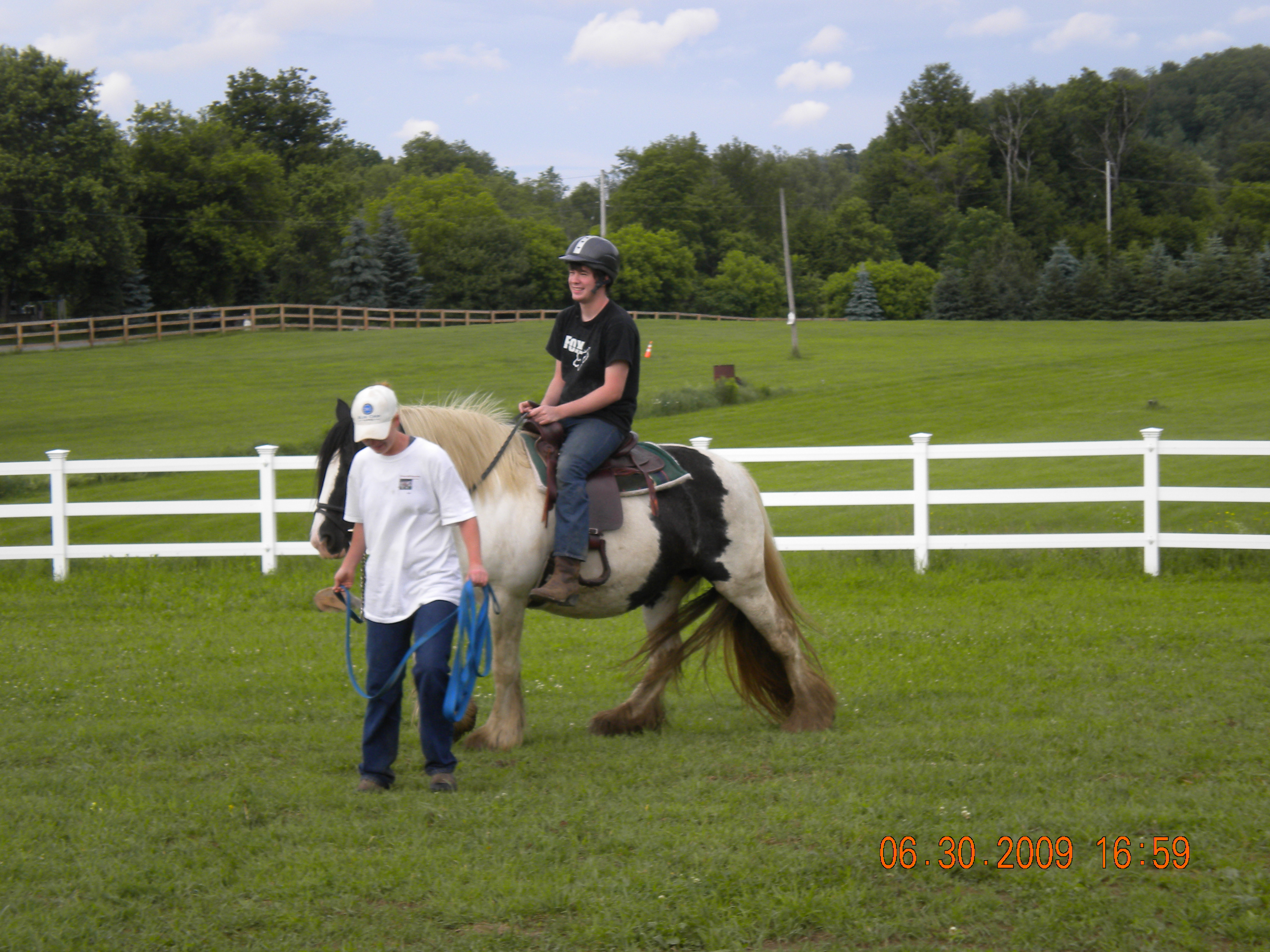 A young Cody learns how to ride a horse.