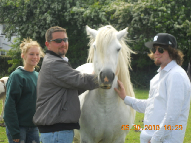 From left, Lexi, Eric and Cody pose for a photo at a Gypsy Vanner horse ranch in Wales in 2010.