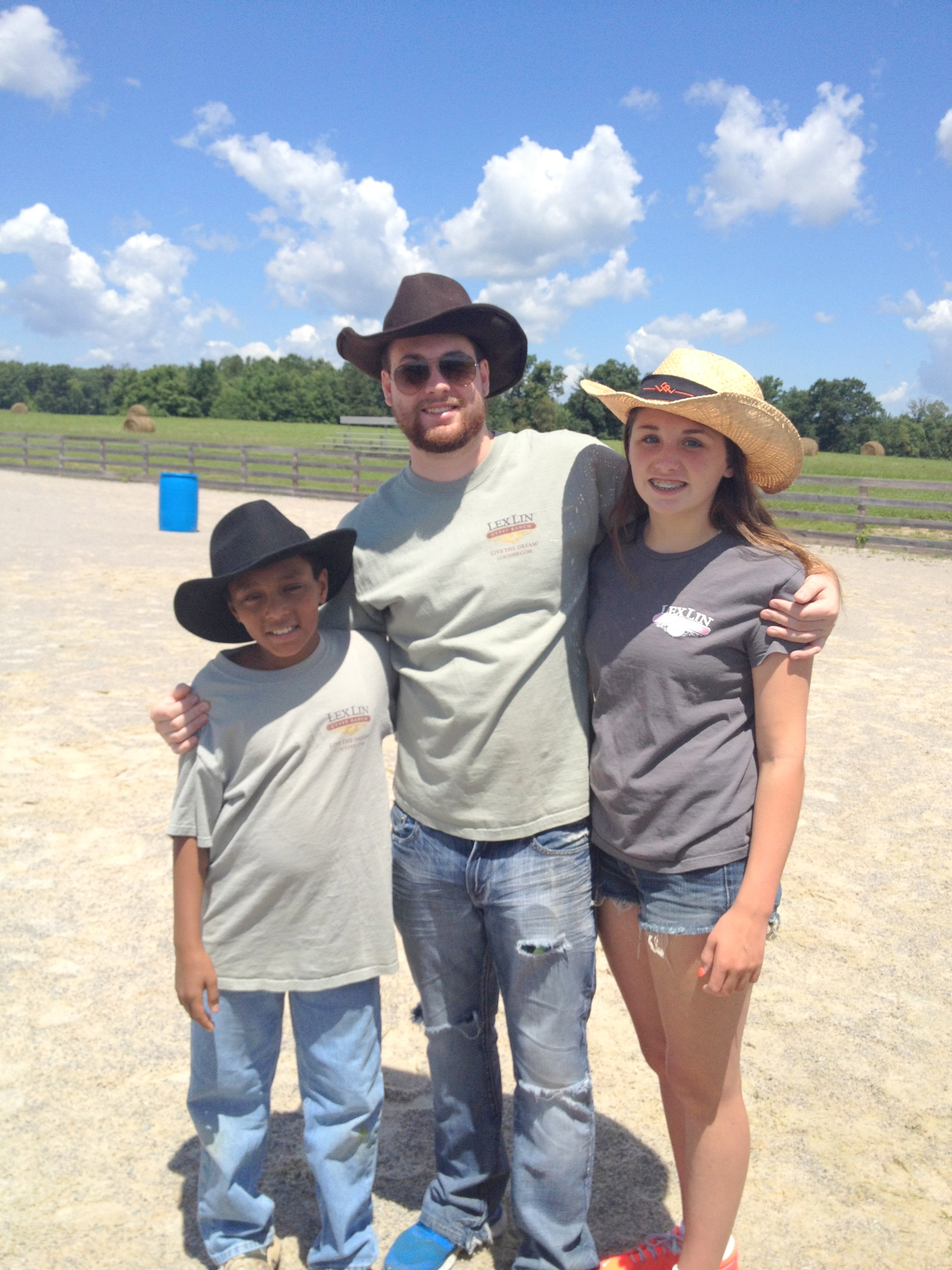 Ben, from left, Cody and Lindie, three of Eric and Mechelle Barton's children, pose for a photo at LexLin Gypsy Ranch.