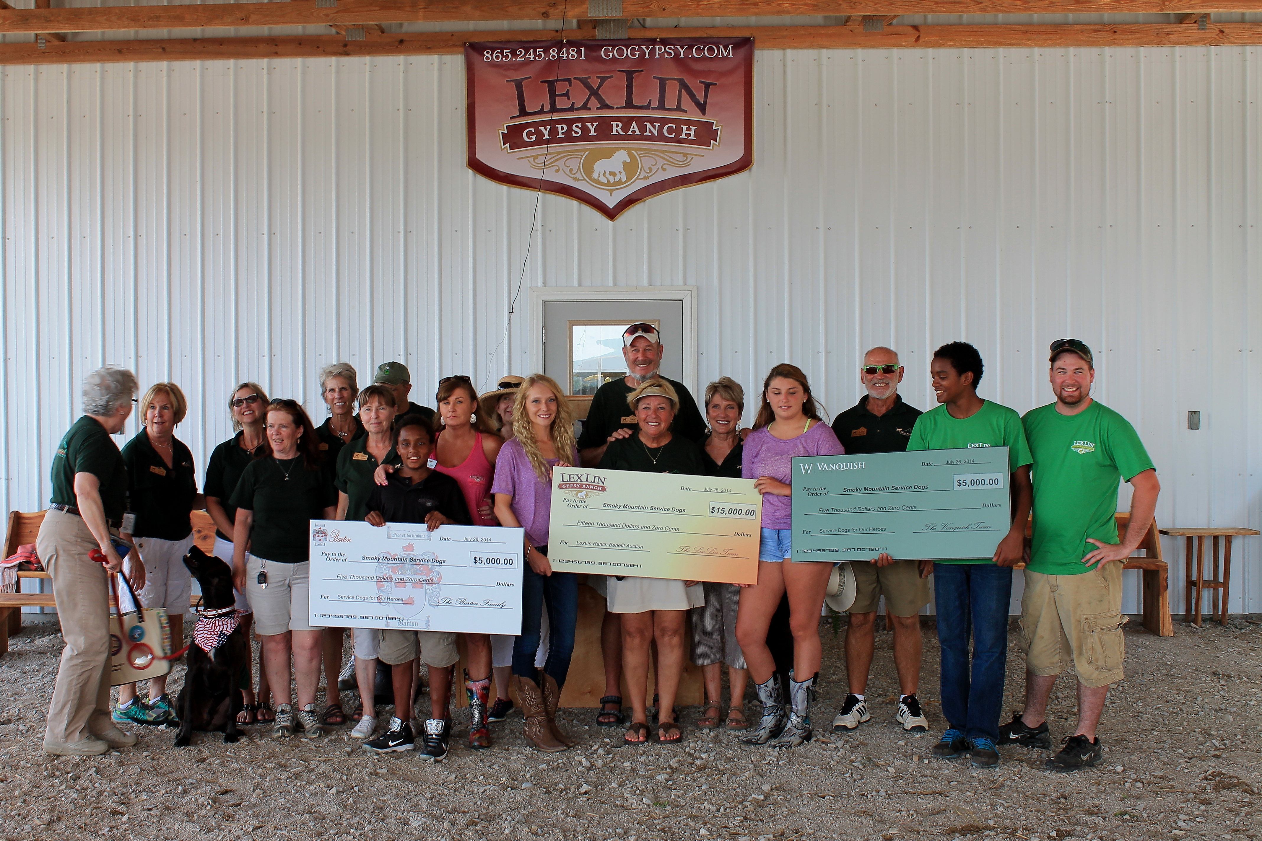 The Barton family, along with their companies LexLin Gypsy Ranch and Vanquish Worldwide make a donation to Smoky Mountain Service Dogs during a 2014 SMSD Benefit Auction at LexLin.